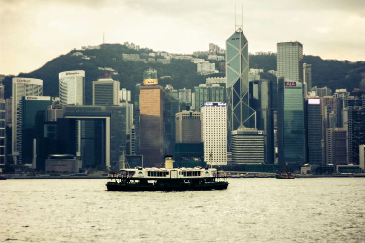 #hongkong #skyscraper #city #contemporary #modern #architecture #view #sea #mountains #hills #boat #ferry