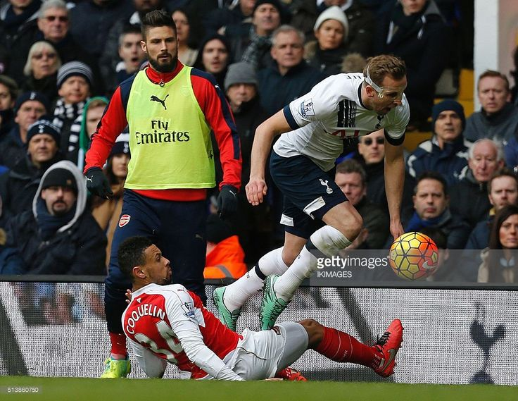 Tottenham Hotspur's English striker Harry Kane is foulded by Arsenal's French midfielder Francis Coquelin (L) which leads to Francis Coquelin receiving a second yellow card during the English Premier League football match between Tottenham Hotspur and Arsenal at White Hart Lane in London, on March 5, 2016. / AFP / IKIMAGES / IKimages / RESTRICTED TO EDITORIAL USE. No use with unauthorized audio, video, data, fixture lists, club/league logos or 'live' services. Online in-match use limited to…