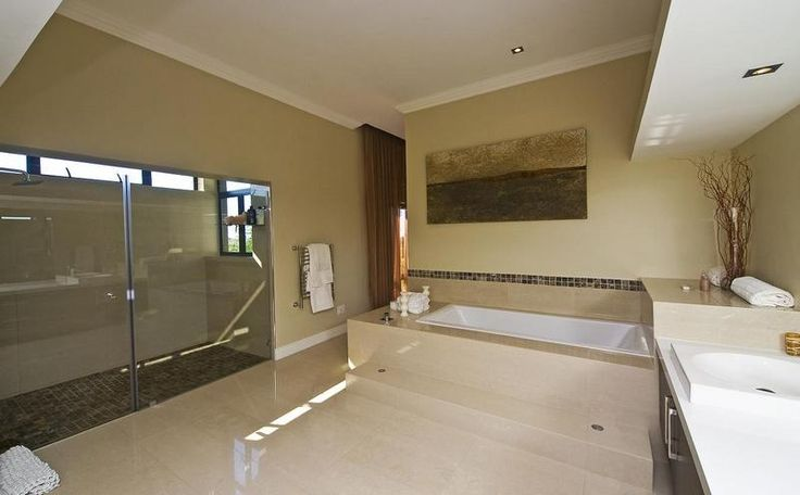huge main ensuite bathroom with underfloor heating, double showers, large bath and his and hers sinks.
