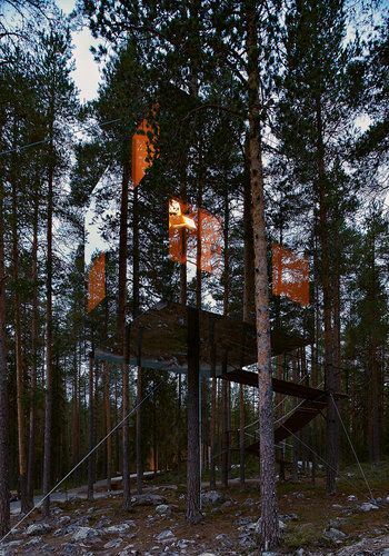 Mirrorcube treehouse - the mirror cladding makes it seem almost invisible.