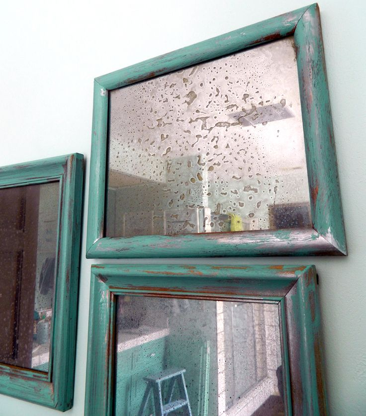 DIY:  Faux Antiqued Mirror (No Chemicals) - mismatched frames,  painted & distressed the same, have their glass sprayed & distressed to look like mercury glass.