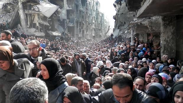 Syrian refugees going to Embassy for food. World News, Headlines and Video - CBS News