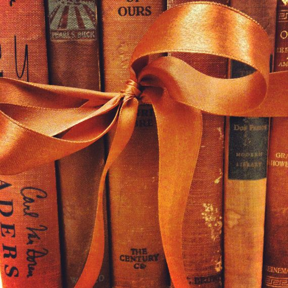 Add a cooordinating ribbon to your books to give the shelf a little pizazz via ZsaZsa Bellagio