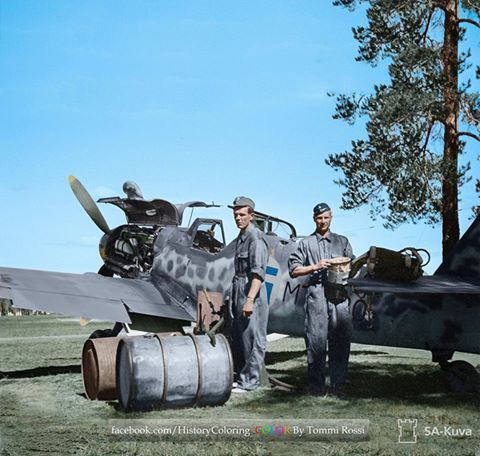 Finnish mechanics refuelling and servicing the Messerschmitt Bf 109G (W.Nr 165464) MT 480 of 3./HLeLv24 possibly at Utti airfield in south east Finland. July 6 1944.