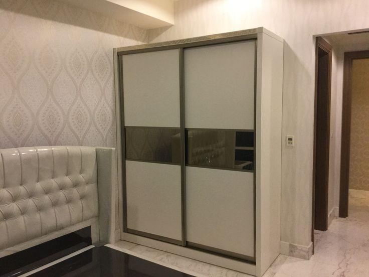 Wardrobe using Vercase logo at Botanica Apartment Jakarta by Simple Luxury Interior Surabaya, Indonesia