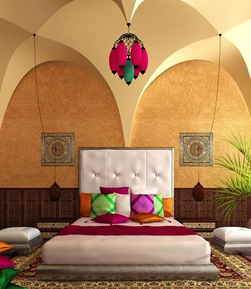 Color rules in this master bedroom. Inspired by Moroccan décor, the room's hanging lanterns, numerous floor pillows and chic wall tiles give the bedroom an eclectic and global flair.  - GoodHousekeeping.com
