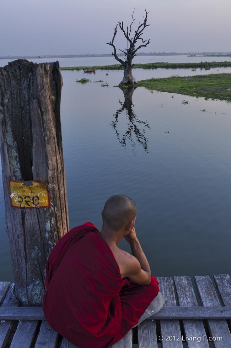 A monk meditating on U Bien's Bridge in Amarapura, Myanmar