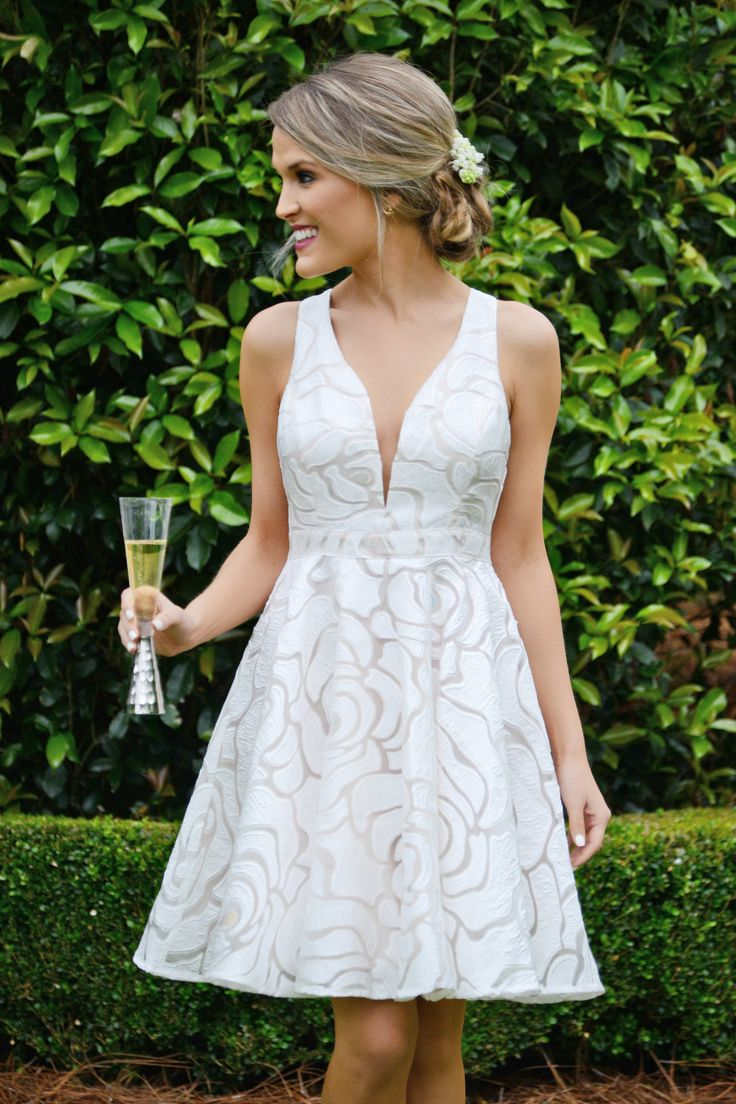Go ahead and take a twirl in this glam dress! A flattering fit and flare shape gets a chic upgrade with that plunging neckline and open back detail. A lovely rose stencil print gets a unique touch with rainbow stitched petals spread out over the dress. Dress is lined.
