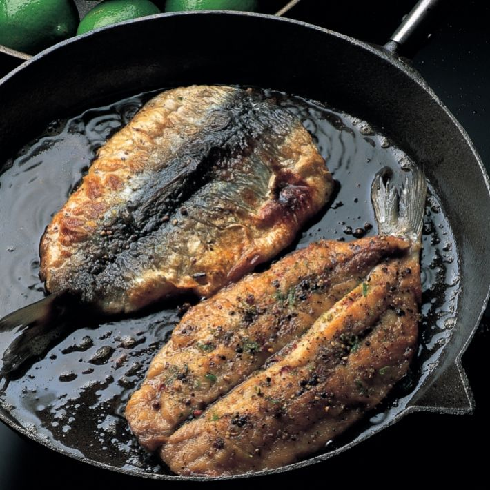 Fish fried herring fillets with a lime pepper crust. (Herring is similar to sardines)