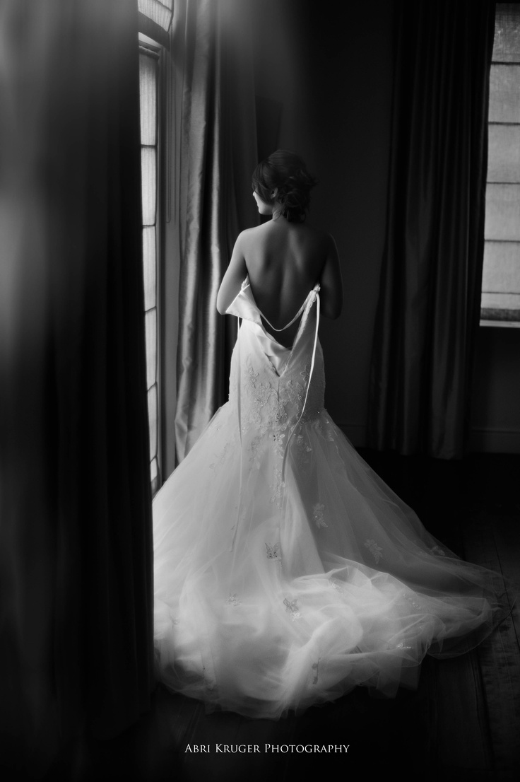 The window light fell beautifully on her dress and back here. I love this image of her getting ready for her big day.