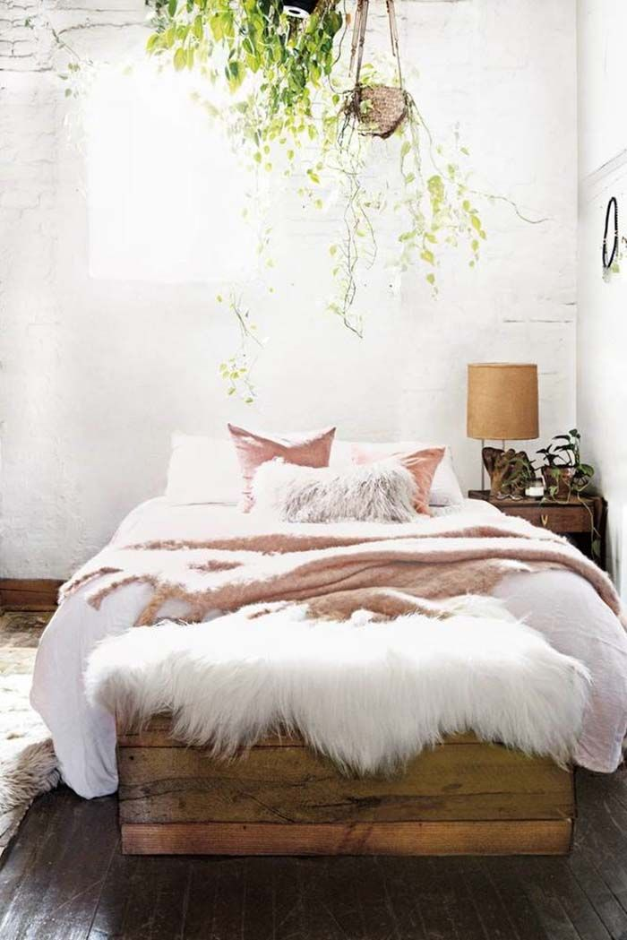 The cozy bedroom scheme above features a light palette of warm textures. A linen duvet is covered with a handwoven mohair blanket.