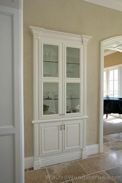 "Convert a small closet to bookcasing ... could even put ""hidden"" storage behind the cabinet"