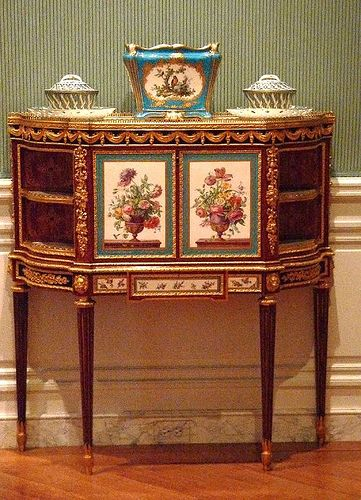 18th century French cabinet with decoration of plaques in porcelain de Sèvres, which was worth its weight in gold at the time.