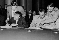 Anthony Nutting and Abdel Nasser sign the Anglo-Egyptian Suez Agreement. 5 November 1956 - Britain and France invade Egypt after nationalisation of the Suez Canal - The Suez Crisis was sparked when Britain and France, allied with Israel, invaded Egypt over its decision to nationalise the Suez Canal - a vital waterway connecting the Mediterranean with the Red Sea. Under American pressure, the canal was handed back to Egypt and the invasion force was withdrawn.