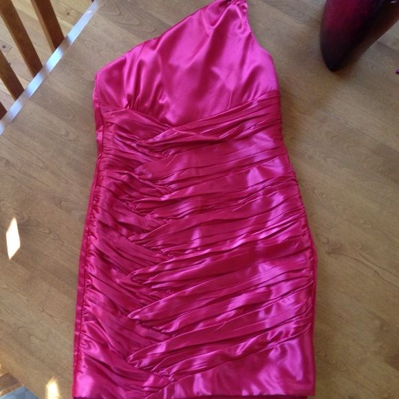Coral formal dress Cute short Coral formal dress. Size 7. Only straps over left shoulder. Worn once. Adorable Trixxi Dresses