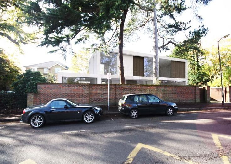 Edge Hill | Wimbledon, London | private home by Dyer Grimes Architects Street view of our contemporary home in Wimbledon popping up behind the existing brick wall.