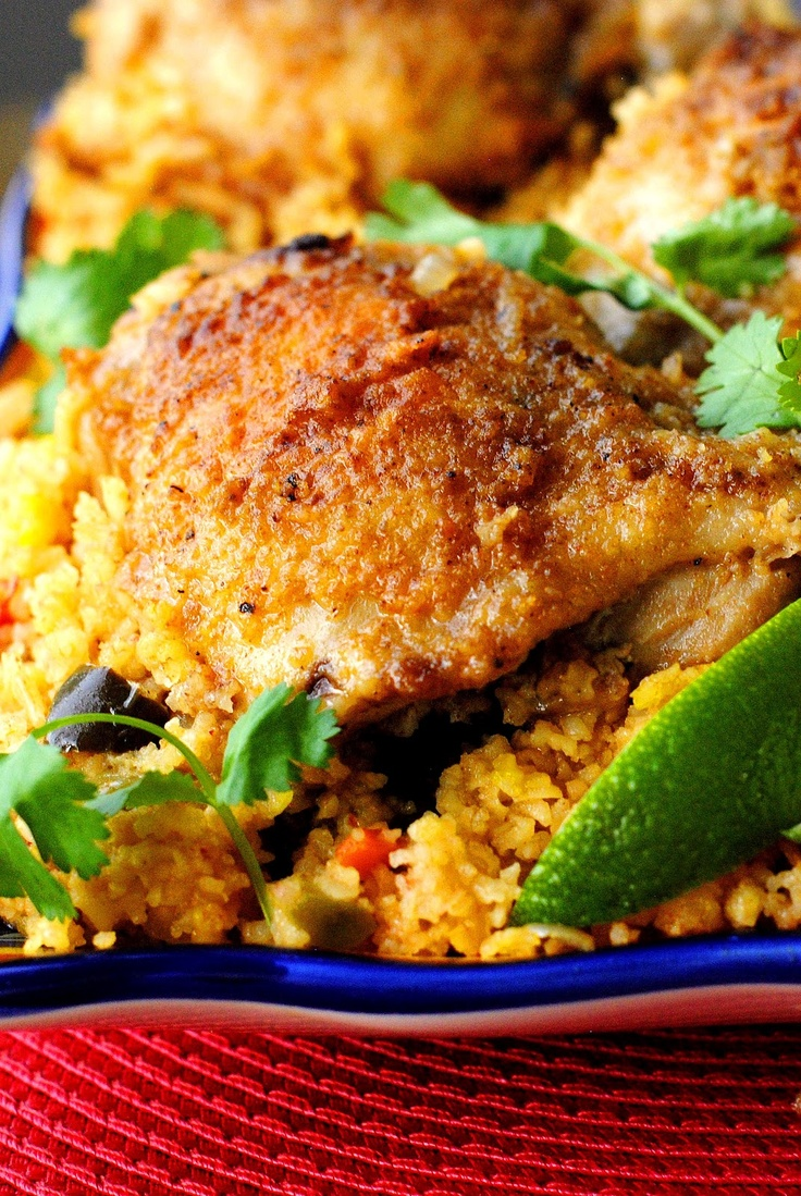 Arroz Con Pollo - Chicken with rice, poblano peppers, olives etc..