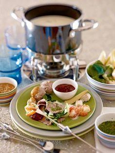 Thai-Fondue mit Fleisch und Fisch