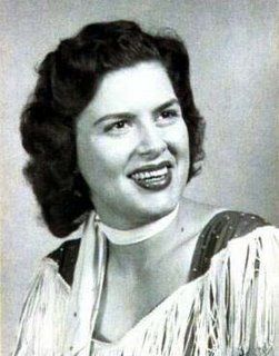 """March 5, 1963: Patsy Cline (30), 'Cowboy' Copas, 'Hawkshaw' Hawkins, and Cline's manager, Randy Hughes, were killed when their Piper PA-24 Comanche plane crashed near Camden, Tennessee, in adverse weather conditions. Cline was famous for her country hit, """"Crazy."""" Copas and Hawkins were Grand Ole Opry stars. The plane flew into severe weather and crashed at 6:20 p.m., according to Patsy's wristwatch, found in a forest just outside of Camden, Tennessee, only 90 miles from the destination."""