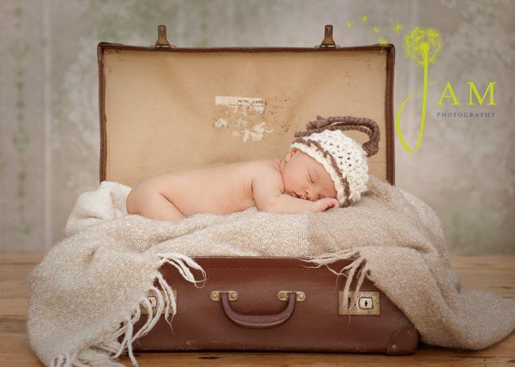 newborn photo in a vintage suitcase -