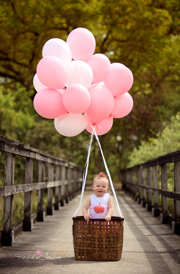 1 year old girl birthday photo ideas | baby hot air balloon | gobs of pink helium filled balloons | baby girl in little basket