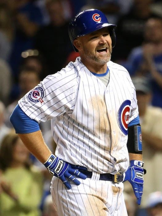 September 20, 2016. Cubs catcher David Ross has a laugh after sliding into home plate head first to score on a double by Jon Lester in the second inning. Cubs 6, Reds 1 Chris Sweda / Chicago Tribune