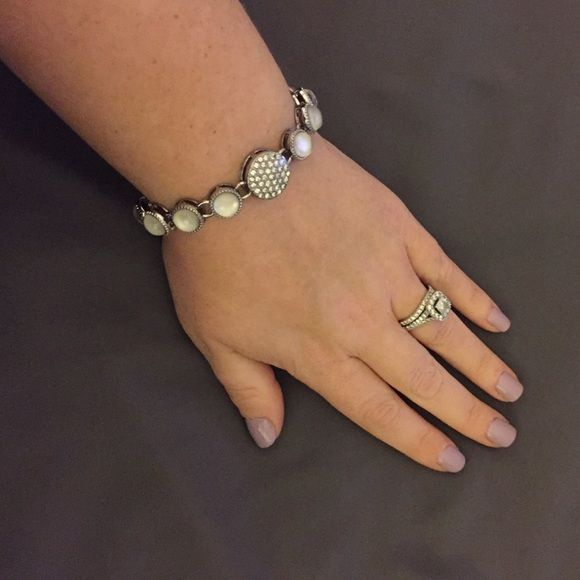 """NWOT Lia Sophia bracelet Bay Breeze 7 1/4"""" bracelet with fold-over clasp. Cut crystals in polished silver, among genuine mother-of-pearl. From Lia Sophia's 2014 spring/summer collection. Great piece to complete any out. Especially great for the holidays! Original box not included. Offers are welcomed, please use """"offer"""" button. Thanks for looking! Lia Sophia Jewelry Bracelets"""