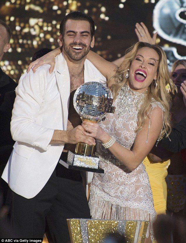 Big winners: Nyle DiMarco and pro-partner Peta Murgatroyd were crowned the season 22 champ...Hearing impared  dancer won!