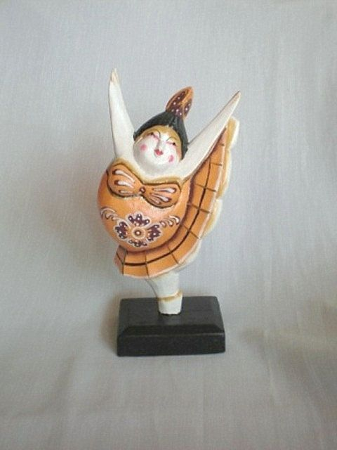 www.etsy.com/shop/ExtravaganzaBali  Wood carved dancer painted with acrylic colors. 23 cm. high. 9.05 inches high.  $17.90 USD