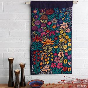 Bright Garden Wall Hanging    Enjoy the brilliance of gorgeous floral color year-round. Meticulously embroidered by women artisans, this cotton wall hanging has mirror accents on the front and a sleeve for hanging on the reverse. 27in. l x 15 1/2in. w
