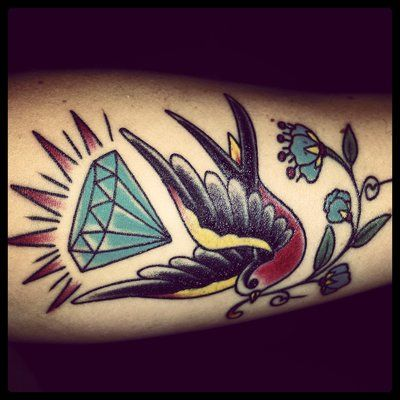 Sparrow with diamond and traditional flower done by Ben Fitzgerald. | Yelp