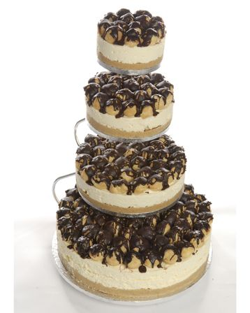 Morning Wedding Ideas - Cheesecake might be a bit much for the am, but love the donut holes on top!