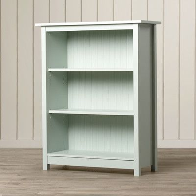 Mint Bookcase from Wayfair Offering simple storage for any space, this understated bookcase showcases 3 shelves and a neutral finish. Set it in your study to stow leather-bound tomes or display framed family photos in the entryway.