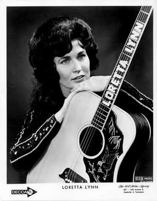 The awesome Loretta Lynn and her subtle guitar, brilliant!