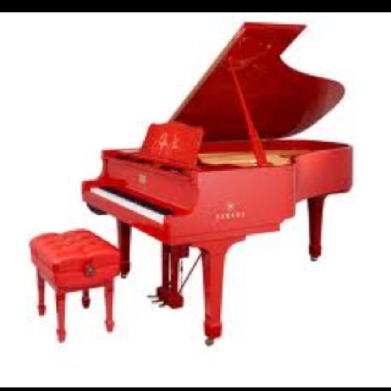 Red grand piano.