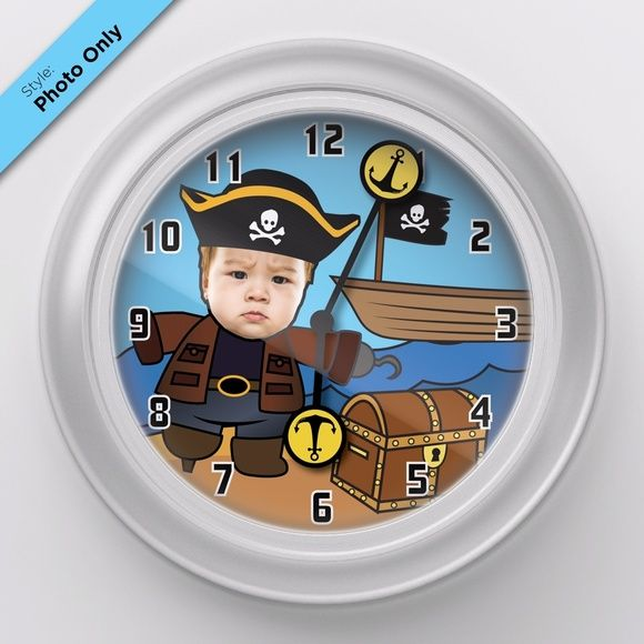 "Personalized Custom Baby Picture Wall Clock Pirate Add your baby's picture to this Pirate themed clock! Watch the treasure map clock arms move around as time goes by.  Simply send me your baby's picture and he will be a adventurous captain!  • Clock dimension: 9.5"" x 9.5"" x 1.25"" • Frosted white frame with clear acrylic cover • Takes 1 AA battery (not included) Qclock Accessories Watches"