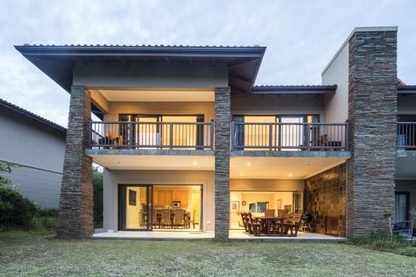 Uluwatu 11 in Zimbali Coastal Resort (Sleeps 7). This fully furnished duplex has an upper level with four bedrooms and three bathrooms. The open-plan downstairs area consists of a fully equipped kitchen, a dining area and a comfortable lounge leading out onto the covered patio. #Where2Stay #Zimbali