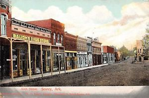 SEARCY-ARKANSAS-VIEW-OF-ARCH-STREET-SHOWING-BAUGHS-DRUG-STORE-POSTCARD-c1910s