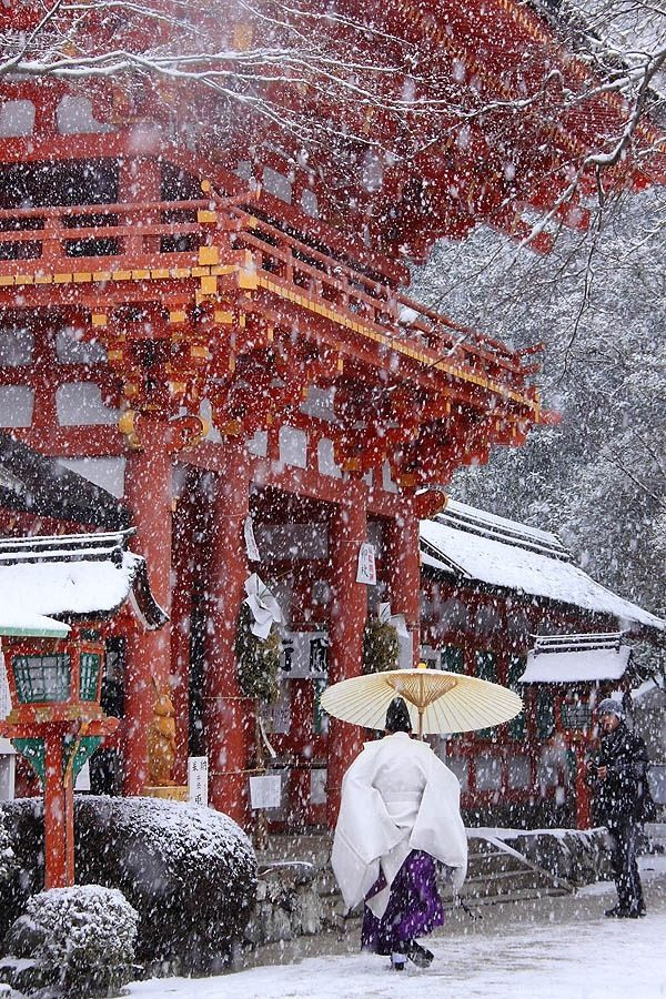 Japanese gentleman in the snow. Beautiful scene.