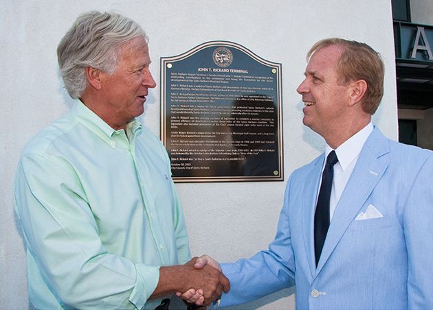 """Dedication of John T. Rickard Airline Terminal."" Randy Weiss, left, community outreach officer for Union Bank, congratulates Dennis Rickard on the dedication of the John T. Rickard Airline Terminal in his father's honor at the Santa Barbara Airport.  Sent by: Lynn Houston / Santa Barbara Airport"