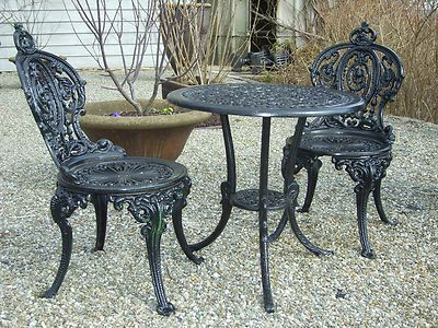 beautiful patio table and chairs it says theyre wrought iron but i think attractive rod iron patio