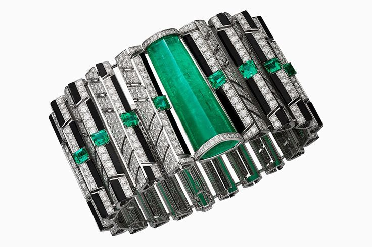"""CARTIER. """"Cinétique"""" Bracelet - white gold, emeralds, onyx, brilliant-cut diamonds. #Cartier #Emeralds ~ETS"""