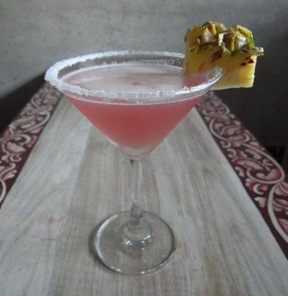 Ruby Relaxer-  1 shot peach schnapps  1 shot Smirnoff® vodka  1 shot Malibu® coconut rum  pineapple juice  cranberry juice