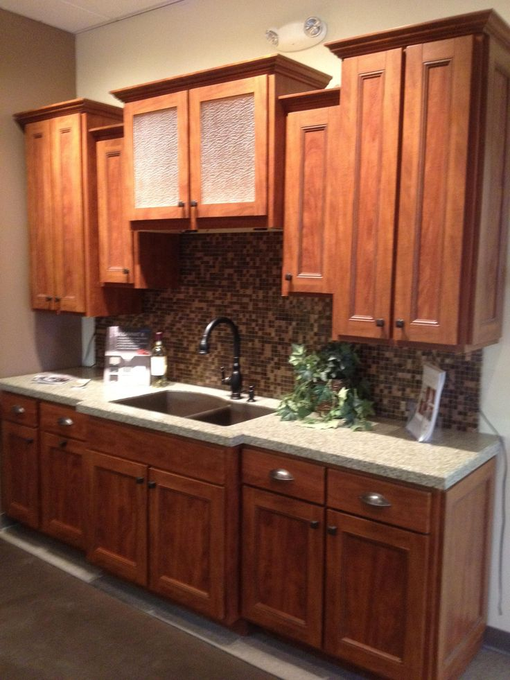 This kitchen transformation is located in our Fenton showroom. Update your cabinets with cabinet refacing and your countertops with our granite overlay, no maintenance product. Granite Transformations of St. Louis Fenton Showroom