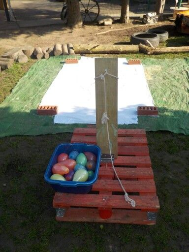 Catapulting paint filled water balloons at Chadwell Pre-school