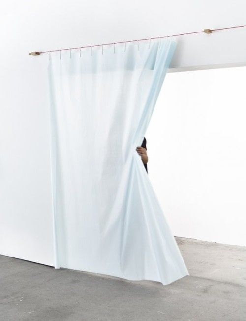 Ready Made Curtain is a minimalist design created by France-based designer Ronan & Erwan Bouroullec. The Ready Made Curtain requires the participation of the owner in its making. Everything one needs to fix the curtain is provided: a hanging cord, wall fixings, pegs, and a selection of Kvadrat textiles. (12)