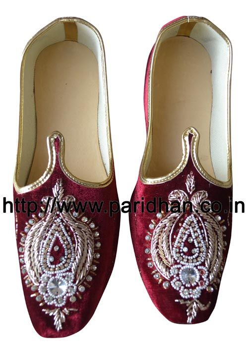 Indian groom wedding mojari made in maroon color uncrushable velvet fabric and thin synthetic sole. These are Handmade Men Wedding Mojari Jutti. They will take the shape of the feet as you wear them. Both shoes in a pair are identical. They will take the shape of the feet as you wear them. Upper Made from maroon color velvet fabric. They have curved toe to give them a traditional and Royal Look. These khussas are made of Flat and thin synthetic soles. Handcrafted by the shoe makers of ...