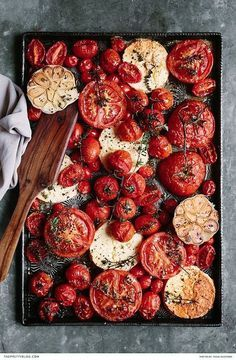 Free baked tomato, feta, garlic & thyme recipe   Photograph by Tasha Seccombe   Recipe by The Food Fox   https://www.theprettyblog.com/food/baked-tomato-with-feta-garlic-thyme/