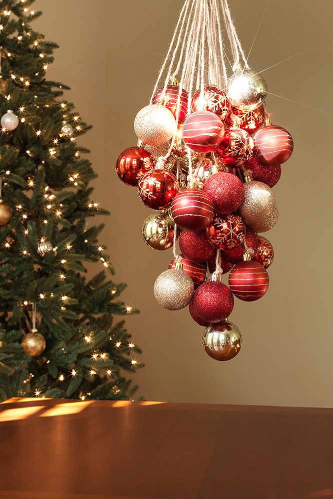 Attach jute twine to Christmas ornaments for a quick and elegant holiday chandelier. Assembly is easy – and so is getting everything you need from this list online.