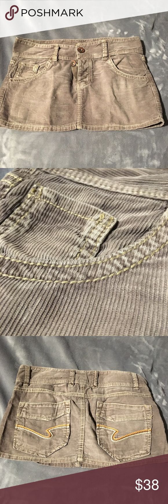"""Brown corduroy mini skirt Super cute grayish brown corduroy mini skirt! Original faded broken in look. Wear it low on the hip with a white tank and high tops. Adorable and in great condition. Length: 10 1/2"""" in front, 12"""" in back Skirts Mini"""